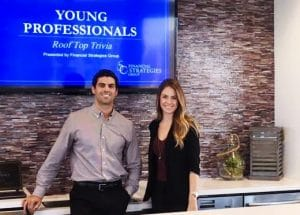 Two young professionals posing at their event.